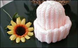 VERY simple hat...but great for a quick knit and new baby.  Love the way it expands, different than a horizontal rib.