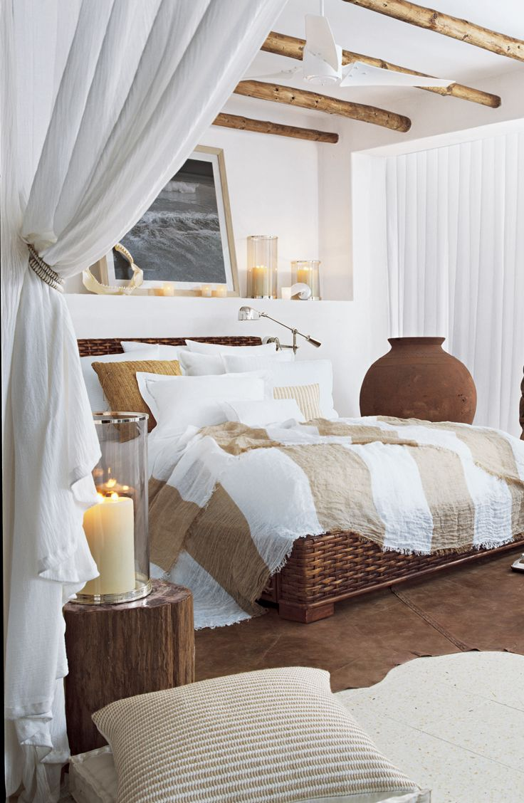 A relaxing bedroom in crisp white and linen bedding from Ralph Lauren Home