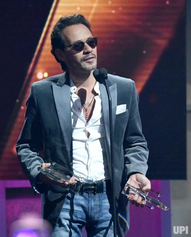 Latin artist Marc Anthony accepts an award during the 2017 Billboard Latin Music Awards and Show at the Bank United Center, University of…