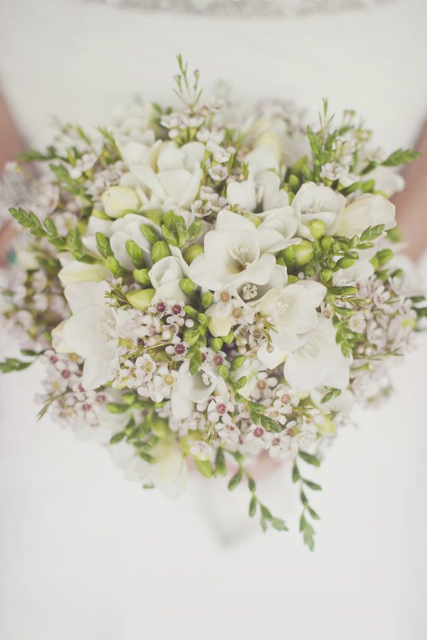 Love freesia and waxflower. Would want to add green fashion or jade roses into the mix... gee I wonder why? Well formed and textured, white and green arrangement