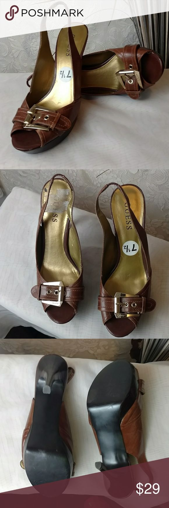 Guess peep toe heels Brown peep toe heels by Guess. Have gold buckle accent. Only wear is trying to get sticker off. Worn only few times. Cute with jeans and suits. Guess Shoes Heels
