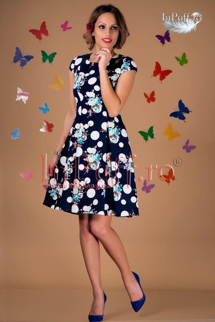 Rochie bleumarin imprimeu floral si buline albe  rochie eleganta dama rochie bleumarin imprimeu floral pliuri in partea de jos rochie in clos dublura alba se incheie cu fermoar ascuns pe spate lungimea de la subrat:74 cm material: 95%poliester, 5%elastan  Rasfata-te InPuff cu cele mai frumoase rochii dama!