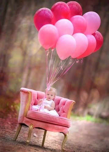 1st birthday pic idea... For a little girl, pink balloons and a stylish chair (a Salvation Army find for $10) set in an unconventional setting make for a memorable photo.