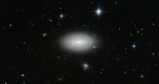 The galaxy MCG+01-02-015, also known as LEDA 1852, got photographed using the Hubble Space Telescope's Advanced Camera for Surveys (ACS) instrument. Read the details in the article!