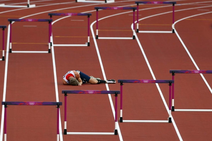 Jack Green of Great Britain after falling in the 400m hurdles at the 2012 London Olympics. (Paul Gilham/Getty Images)
