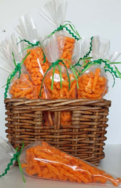 "Easter ""carrots"" made using Cheetos (or you could use Goldfish crackers) and piping bags from Wilton."