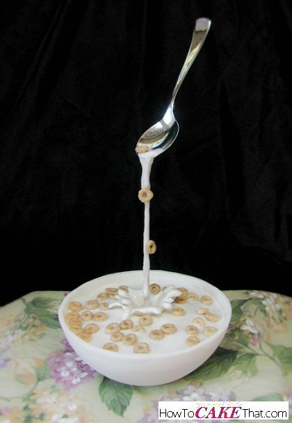 Complete free photo tutorial on how to make this anti-gravity bowl of cereal cake! The silver spoon seems to float in the air as milk spills into an edible bowl of cheerios.
