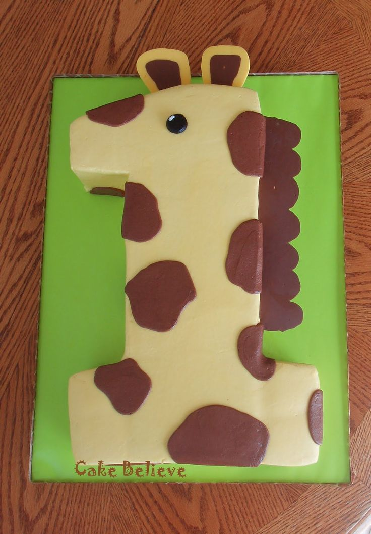 Cutest first birthday cake ever!!! If Thomas still likes giraffes by the time he turns one I will have to try to do this!