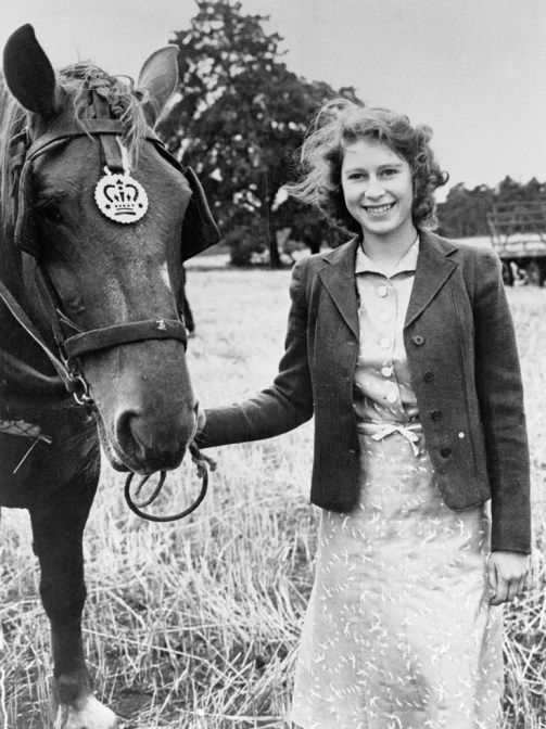 Young Princess Elizabeth, beaming a happy smile. From #QueenElizabeth's Royal Love of #Horses on www.AuthorAngelaBell.com.