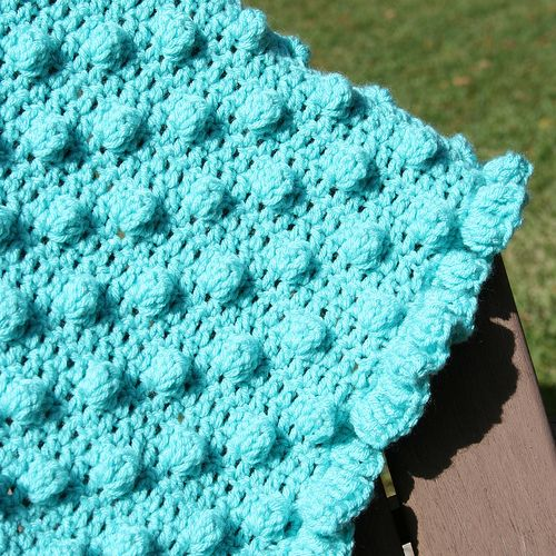 Learn how to crochet a blanket with this fun Polka Dots & Frills blanket. The teal color is perfect for the summer.