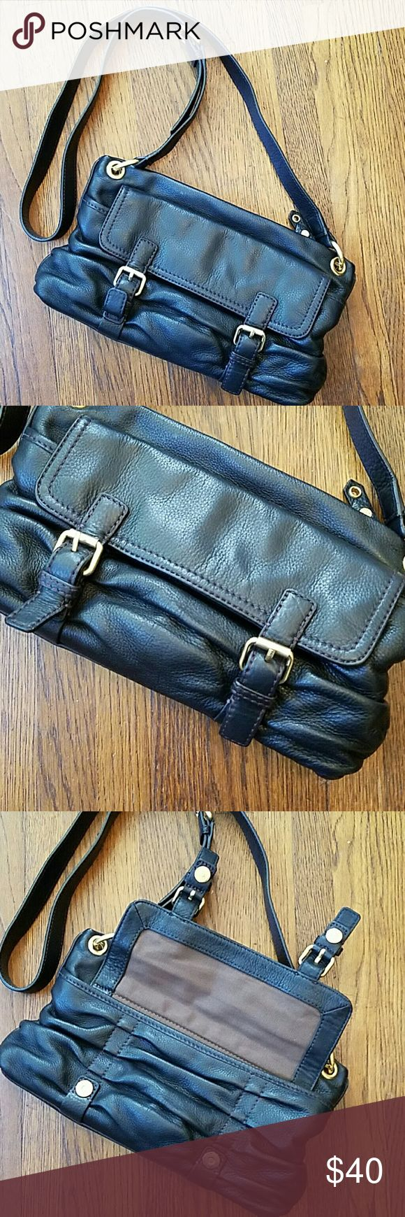 Cole Haan black leather cross body purse Cole Haan black leather cross body purse. Long strap is adjustable. Exterior is excellent, interior is stained as shown. Cole Haan Bags