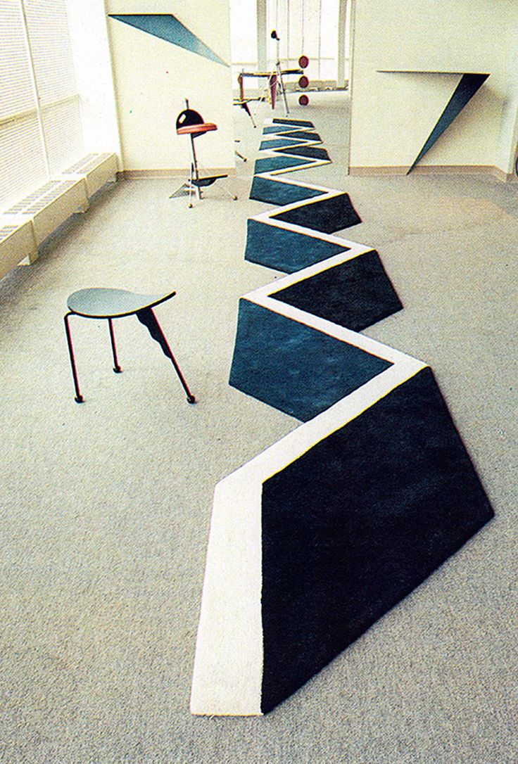 Love, love, love this. When we looked closely at this 3D rug, we realized that it was really an assemblage of simple shapes that LOOKED way more complex that in is. Very cool