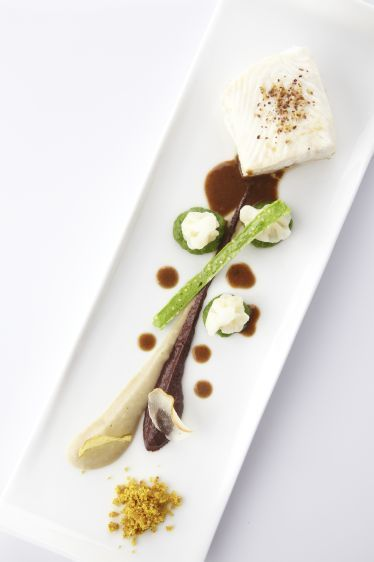 Een overheerlijke pladijs met witte pens, broccolicrème en bloemkoolroosjes, die maak je met dit recept. Smakelijk!