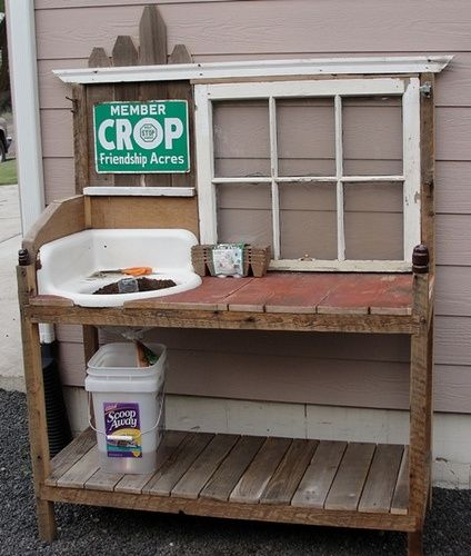This potting bench was made from old salvaged materials; the sink, window, wood pallets, etc.