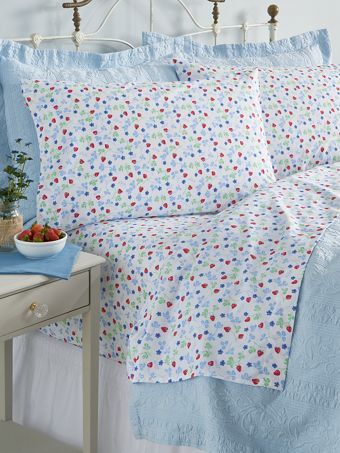 Sweet Lanz strawberry print percale sheets that are as bright and happy as you'll feel slipping into these percale bed linens with a soft, smooth feel and vintage print.