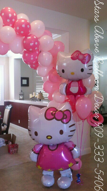 Hello Kitty Themed birthday arch, bouquets & air walker!