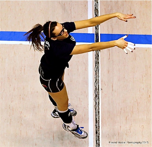 Marisa Field putting up a nice block -- photo courtesy of Pascal Mistral Photography