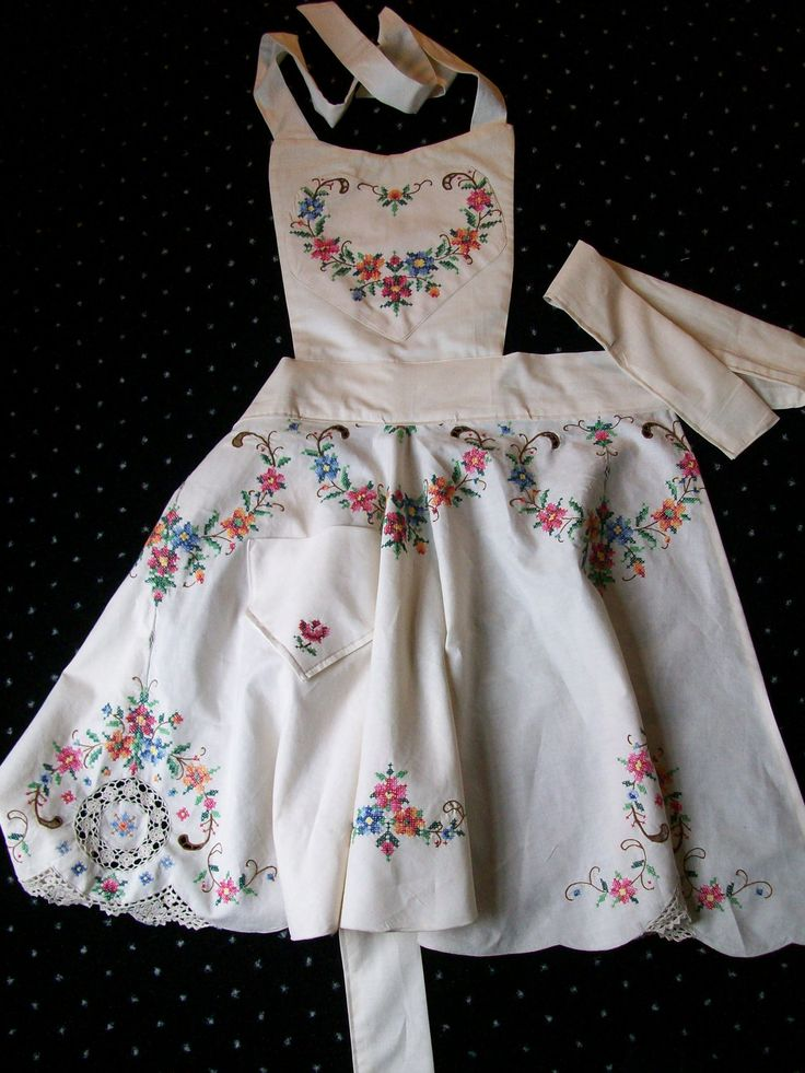 Vintage Flower Print, Cross Stitched Tablecloth made into an Apron.  Awesome.