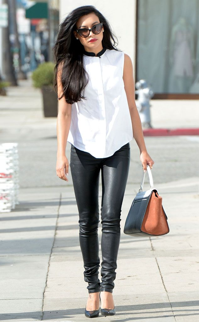 Naya Rivera makes a sidewalk style statement in fierce leather leggings and a mandarin collar top.