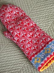 This mitten is lined and the liner is knit first to fit the hand. The outer mitten is knit afterward.
