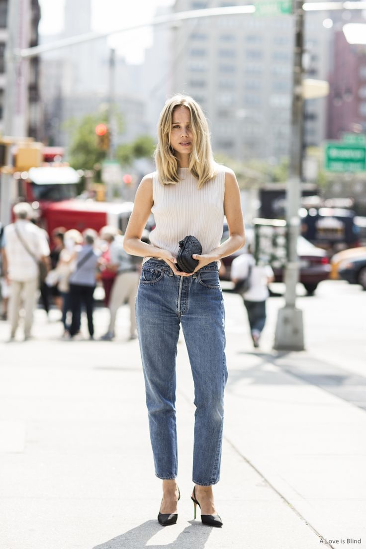 The pleated cream colored top gives the Vintage Levi's an elegant upgrade.