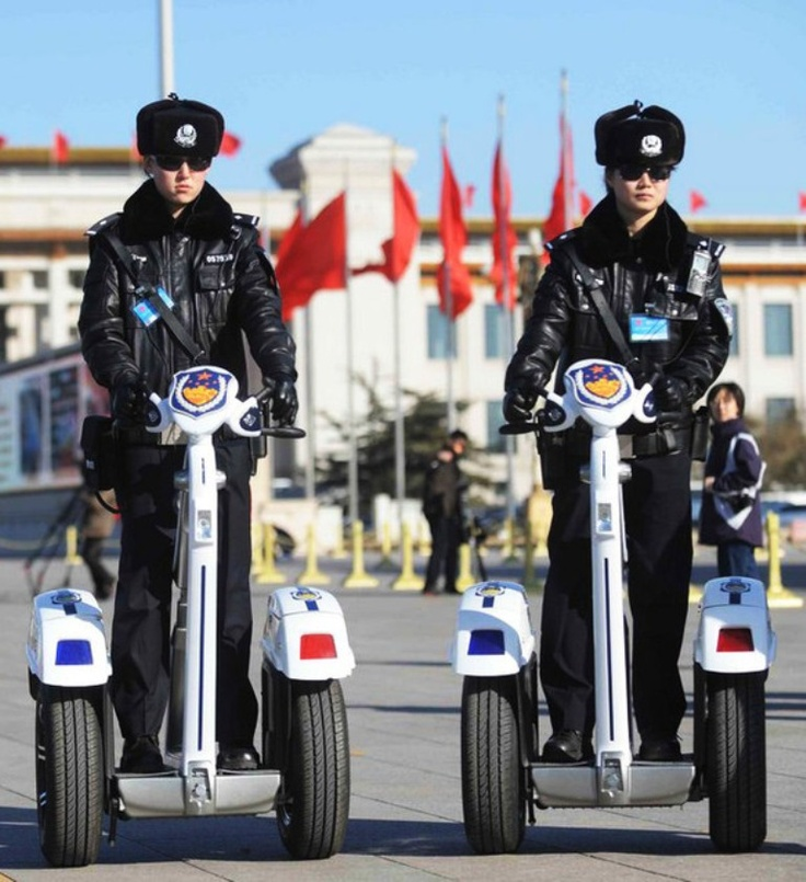 China Police: Chinese Female Police Officers Patrol On Segways