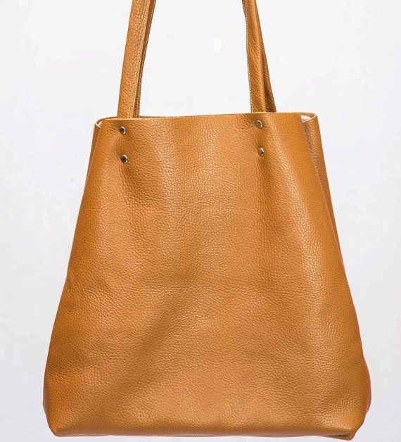 You can find more pictures here https://www.facebook.com/MrArtigiano/  This brown leather tote bag is everyones favourite! This minimalis brown