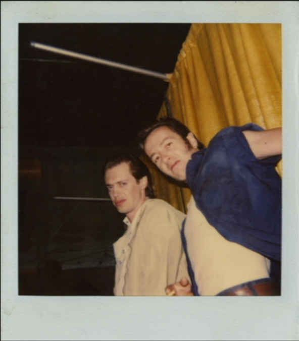Buscemi and Strummer both smile happily for the camera on the set of their 1989 film, Mystery Train . | This Photo Of Steve Buscemi And Joe Strummer Hanging Out Together Might Be The Coolest Thing Ever