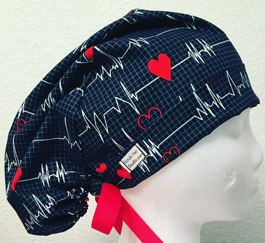 EKG print cotton tie back scrub hat with ribbon ties, adjustable front band, and elastic back.