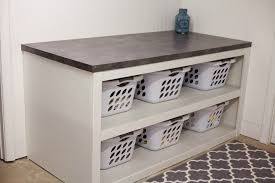 laundry folding table: across from the washer and dryer is my folding table and laundry basket sorter this might