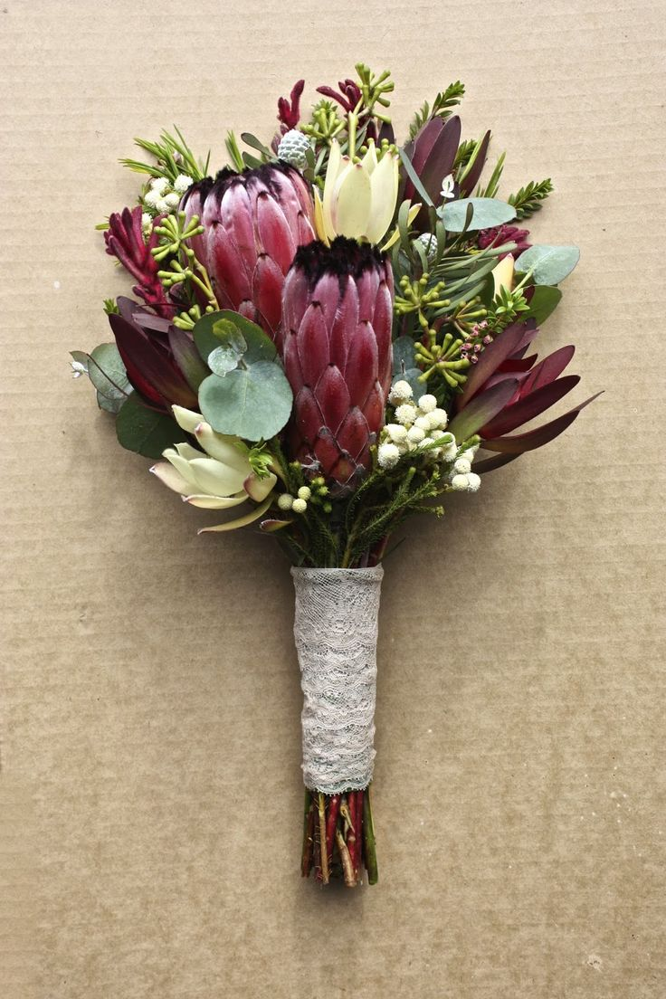 rustic vintage style native bridesmaids bouquet with proteas, leucadendrons, berzelia, kangaroo paw and eucalyptus pods