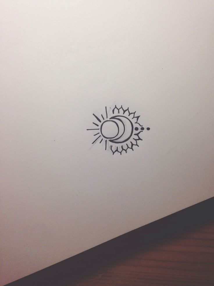 My futur tattoo. I drew it myself. A moon with a sun, three points and some spikes, which remain the sun and in my opinion a lion. I believe it would look nice on my wrist. Personal signification for the moon encircling the sun, so as for the spikes. Take some inspiration, please do not copy it, a tattoo's supposed to be personal.