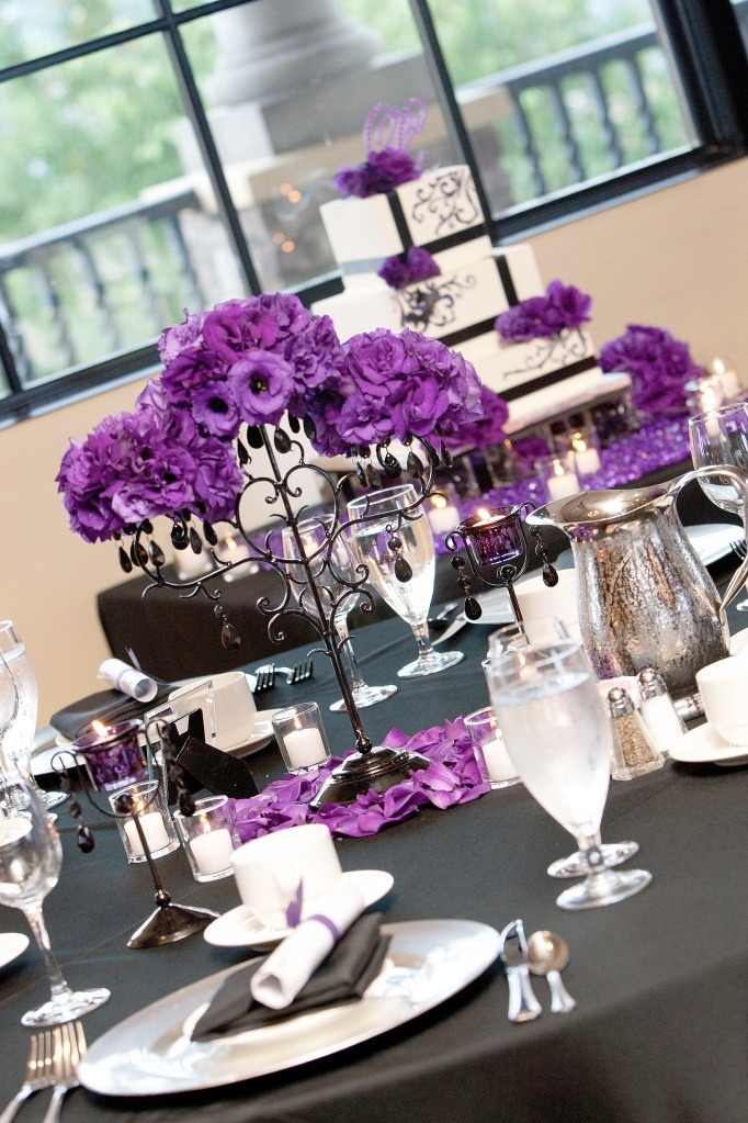 I like this centerpiece if the flowers were darker purple. Also- they seem to be a bad height- not low enough to talk over and not high enough to talk around. might also look better w a bit of dusty miller (These centerpieces are different - more like a candelabra than a vase.)