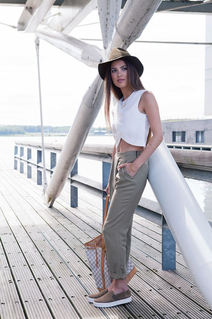 Just the right balance between laid-back, chic, and feminine.  White Top Zara Trousers  Vince Slip Ons Louis Vuitton Noe bag  Green hat Ray Ban Sunnies