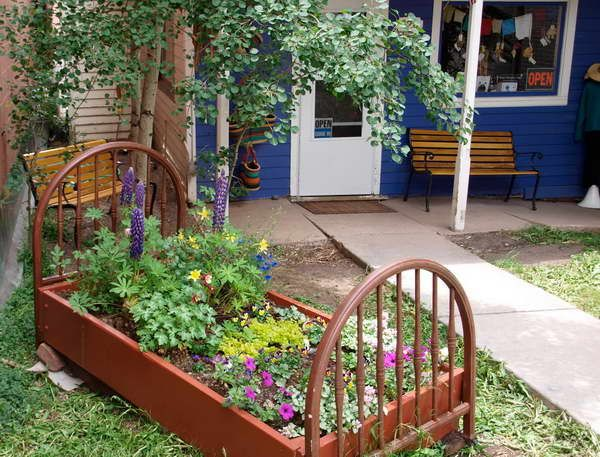 Flower bed fencing with park bench unique flower for Flower bed fencing