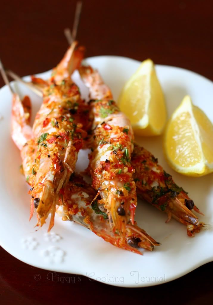 grilled prawns | 500g large prawns, 1.5 bulbs garlic, peeled, 3 medium size red chillies, 3 stalks flat leaf parsley, 5-6 tablespoons olive oil, Salt & black pepper, to taste, Bamboo skewers, 1 lemon, cut into 4 wedges.
