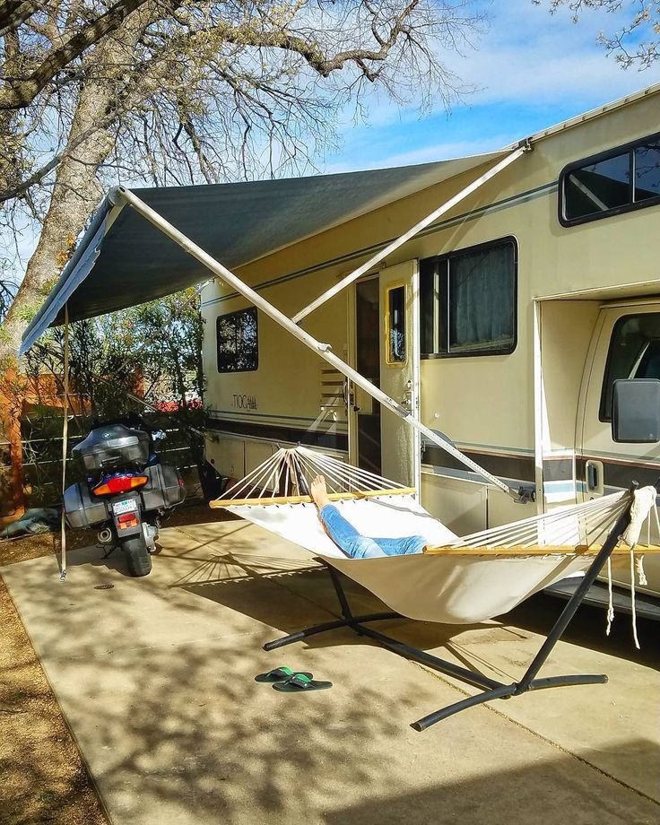 Day 296 - Bertha got a new awning today! We've been without one since August and now our lives are complete it feels like we have a real front porch...the hammock even came out of storage!... #rvlife #lifeontheroad #homeiswhereyouparkit #homeonwheels #gorving #fulltimerv #roadtrip #tinyhouse #tinyhome #wanderer #nomad #explore #adventure #wanderlust #getoutside #travel #traveler #hammock #livinthedream #bigbertha #norcal #redding #california