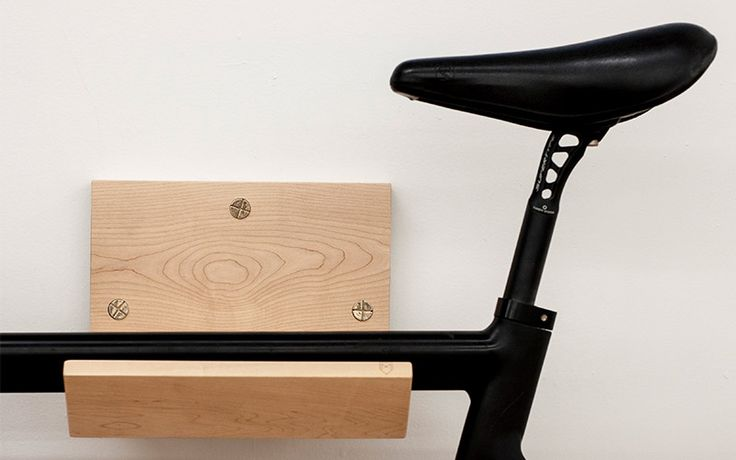 The first product by Make. Wall mounted bike rack and shelf to store your bike inside and expose it. Made out of solid wood (walnut or maple) with custom hand made bronze screw caps to hide mounting screws.