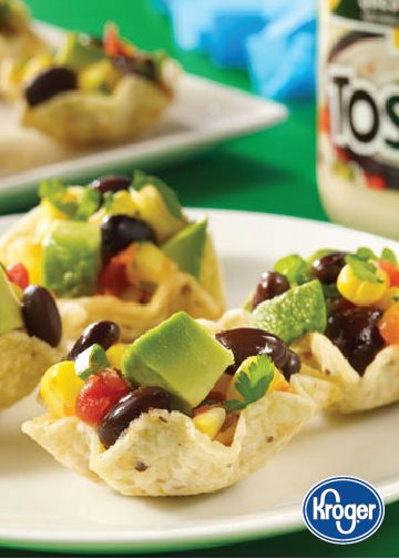 Black Bean Corn Bites — Stuff your salty, crunchy Tostitos with a flavorful salsa made of creamy avocado, hearty black beans, sweet corn, and tangy cilantro for a Mexican-inspired finger food that can't be beat. For more bold flavors and snacks that pack some heat, check out Inspired Gathering.