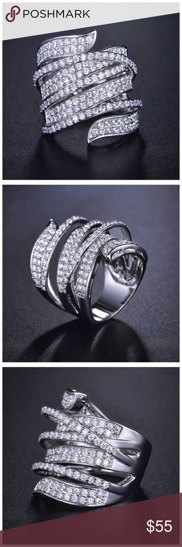 """🆕 Swarovski Crystals 3D Statement Ring DF101 ‼️ PRICE FIRM ‼️ 10% DISCOUNT ON 2 OR MORE ITEMS FROM MY CLOSET ‼️   Handmade Using Swarovski Crystal Ring   Retail $122  To say that this is a spectacular ring would be an understatement. Beautifully & skillfully handcrafted using the finest Swarovski crystals with a 14K white gold overlay. This is a true statement piece. Pave set crystals. Ring is approximately .75"""" wide. Comes with a beautiful gift box. Jewelry Rings"""