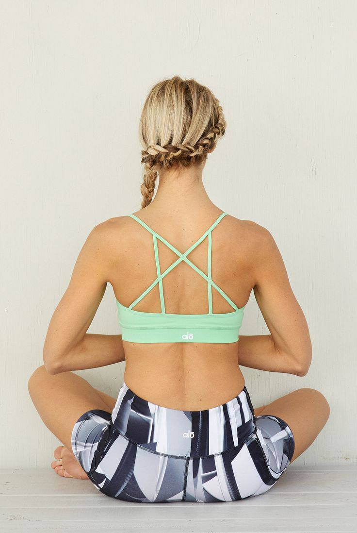 661rt We are LOVING this super cute Goddess Sports Bra from Alo Sport! Check it out in White and Envy (green shown)! This is the perfect bra for this season's open back trend! Show it off with some of the gorgeous tanks and tops from the new Spring/Summer collection from Alo Sport at http://evolvefitwear.com