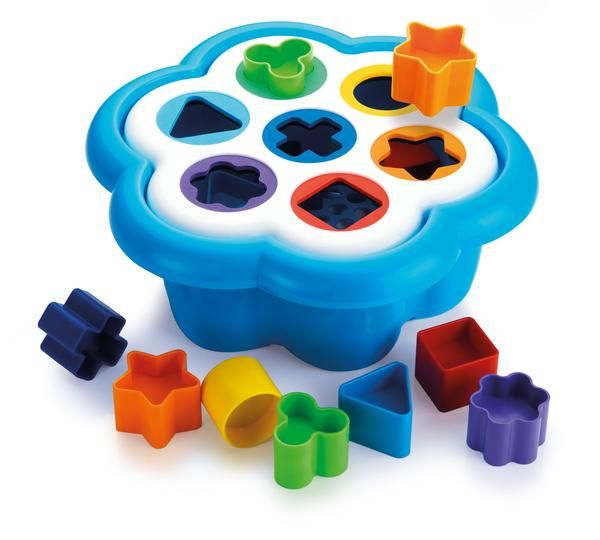 """A timeless favourite: this is the classic """"shape sorter toy"""" in a brand new and original version. It features a daisy-shaped base with seven holes in different sizes and bright colours, each corresponding to the blocks that your little one will learn to recognize and drop into the right hole.Each shape is coordinated with a different colour so that children can easily find the matching pieces and sort them by shape and colour, strengthening their hand-eye coordination, as well as th..."""