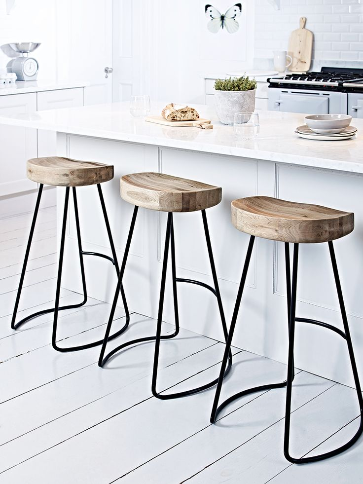 A contemporary twist on our bestselling Weathered Oak Stool, this stylish high stool features natural oak seat which has been carefully carved for your comfort and a sturdy iron frame. With a handy iron rung to rest your feet, this robust stool combines classic and industrial materials to create a stylish seat for your breakfast bar.