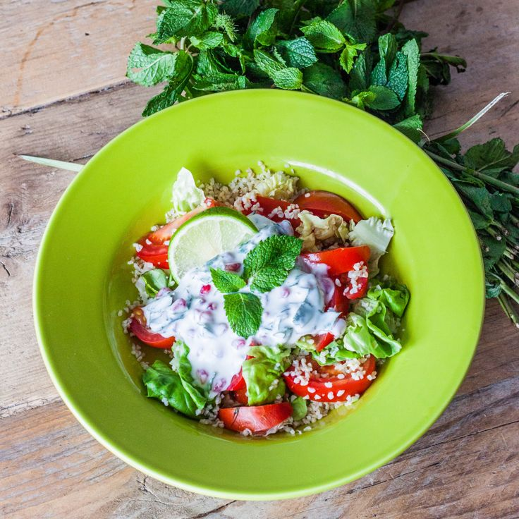 , Green Leaves and a Yogurt Dressing with Pomegranate Seeds & Mint ...