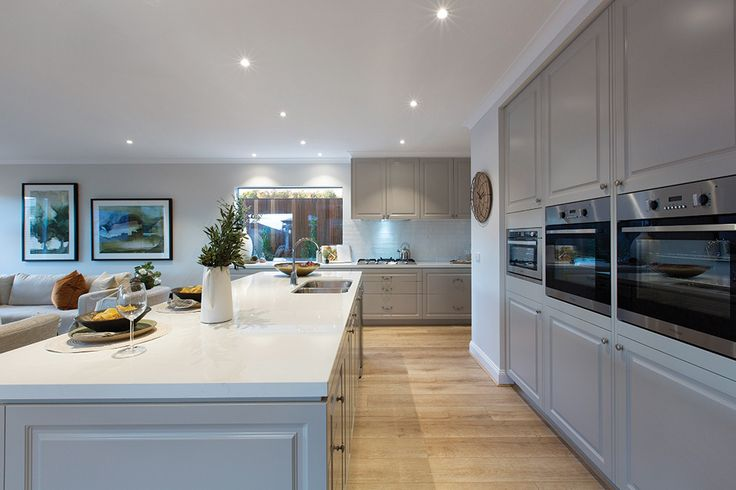 Open plan kitchen in the Forsyth display with a Tuscany World of Style.