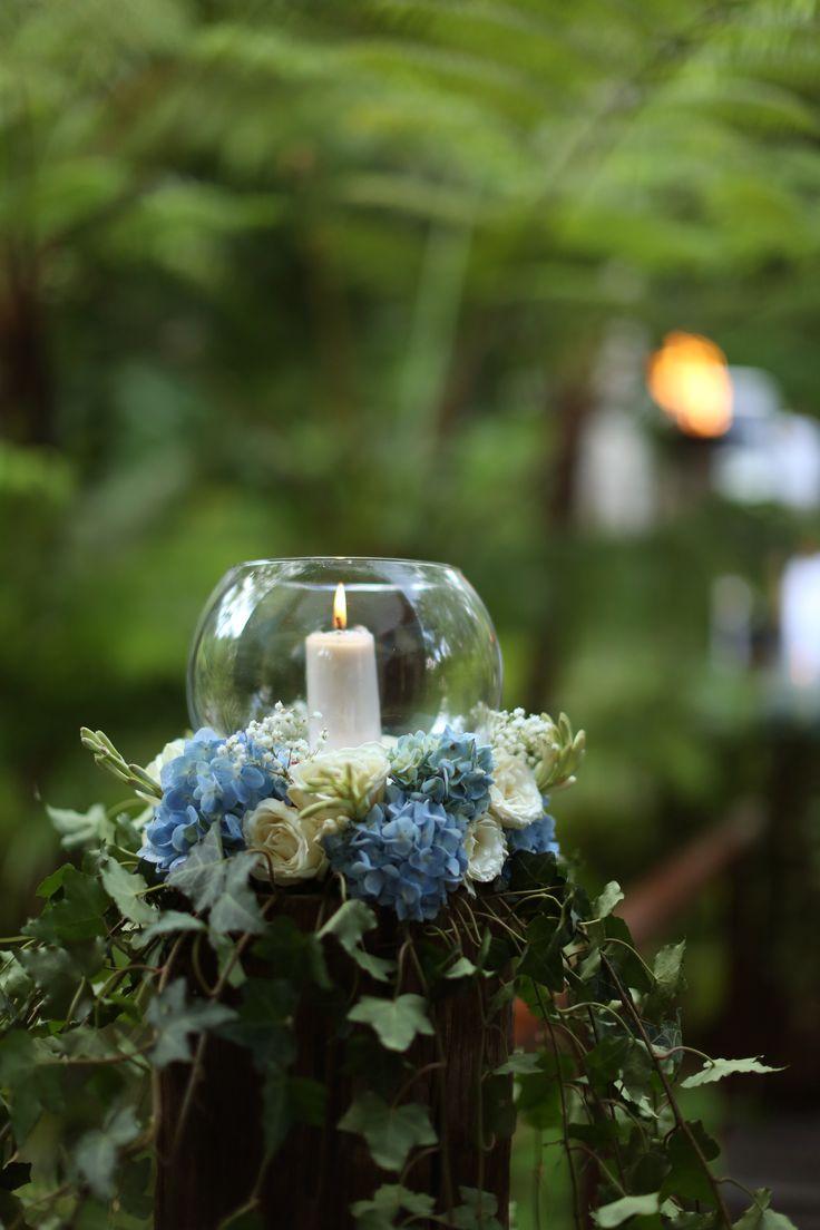 flowers candle at Wanasmara chapel Komaneka at Bisma Ubud - Bali, Indonesia. image by imajgallery. see komaneka.com
