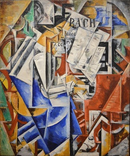 At the Piano 1916. Nadezhda Udaltsova (1886-1961) was a Russian avant-garde artist (Cubist, Suprematist) and painter. The Udaltsova crater on Venus is named after her. Her son was the prominent Russian sculptor Andrei Drevin (1921–1996).