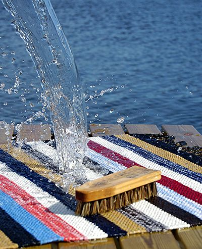 Washing the carpet outdoors. Finland. Maton pesulla