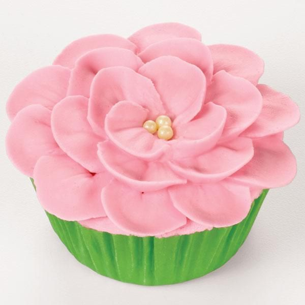 Piping a Flower on a Cupcake--This technique will work for larger petal tips, such as tip 125 used here. Try your favorite petal shapes to create your own fantasy flower.