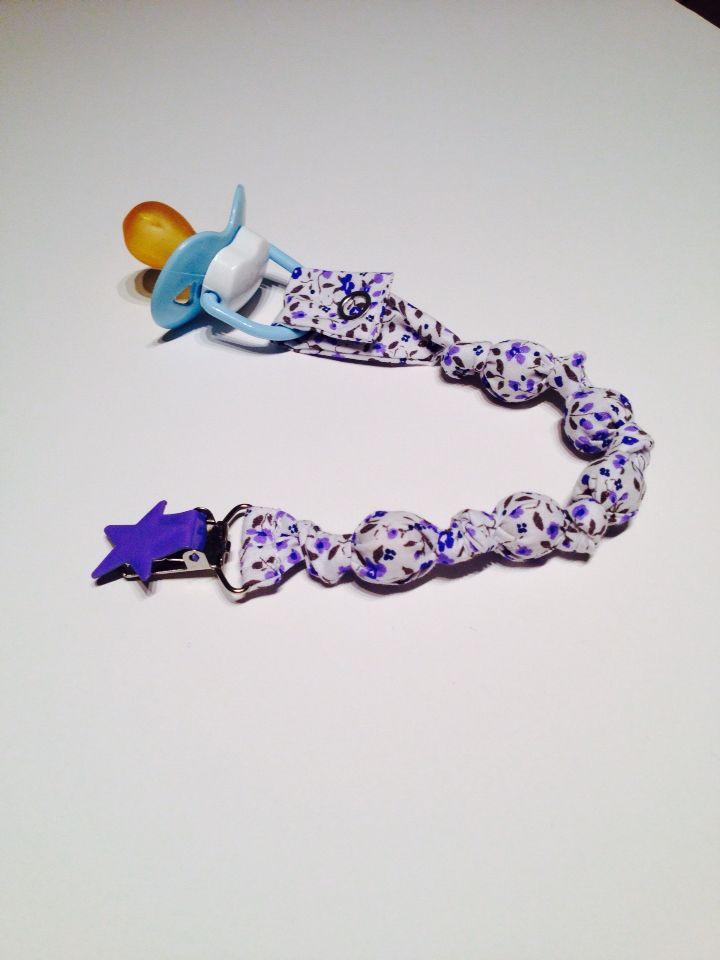 Portachupete para bebé estampado flor azul